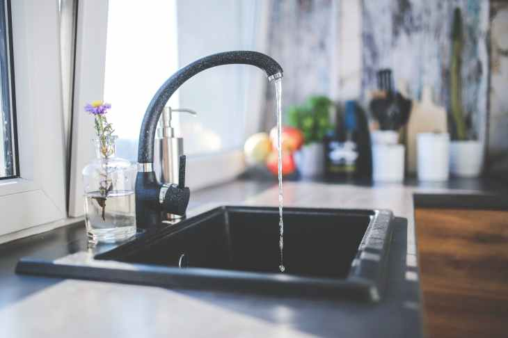 water flows from the tap to sink