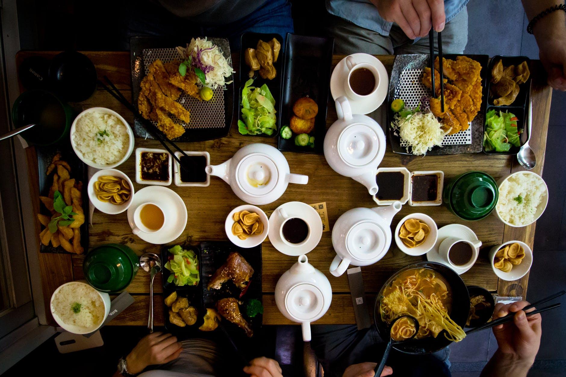 flat lay photo of katsu tea set and bowl of ramen